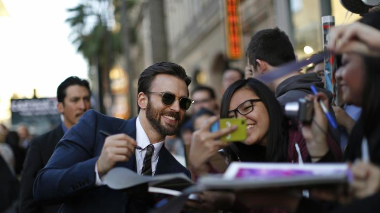 "Cast member Evans signs autographs at the premiere of ""Captain America: The Winter Soldier"" at El Capitan theatre in Hollywood"