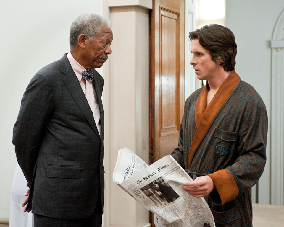 "This undated film image released by Warner Bros. Pictures shows Morgan Freeman as Lucius Fox, left, and Christian Bale as Bruce Wayne in a scene from the action thriller ""The Dark Knight Rises."" (AP Photo/Warner Bros. Pictures, Ron Phillips)"