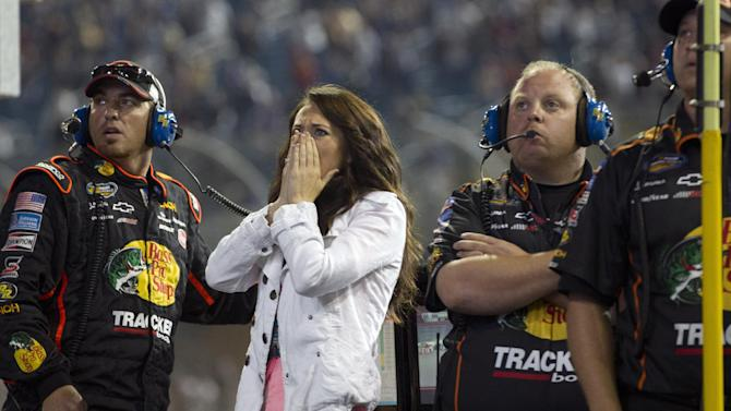 Haley Carey, center, Ty Dillon's girlfriend, reacts as Dillon wrecks during the final laps of the NASCAR Nationwide Truck Series auto race on Friday, Nov. 16 2012, at Homestead-Miami Speedway in Homestead, Fla. (AP Photo/J Pat Carter)
