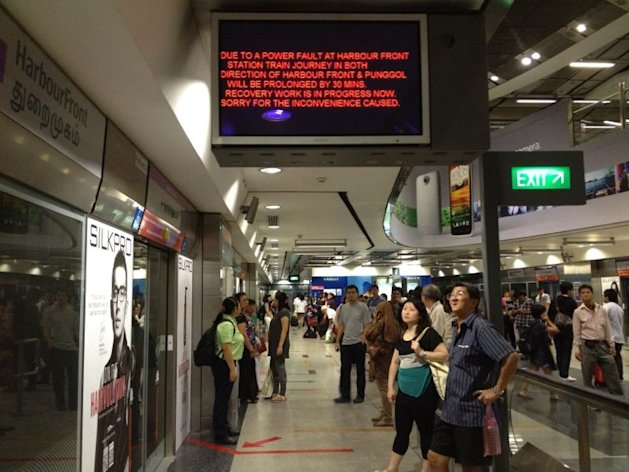 The updated announcement at HarbourFront station informing passengers of a 30 minute delay. (Yahoo! photo)