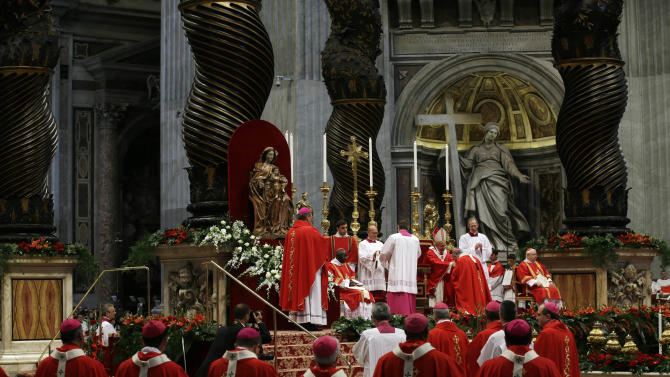 Monsignor Duro Hranic, of Croatia, is greeted by Pope Francis after receiving the Pallium, a woolen shawl symbolizing his bond to the pope, during a mass in St. Peter's Basilica, at the Vatican, Saturday, June 29, 2013. (AP Photo/Gregorio Borgia)