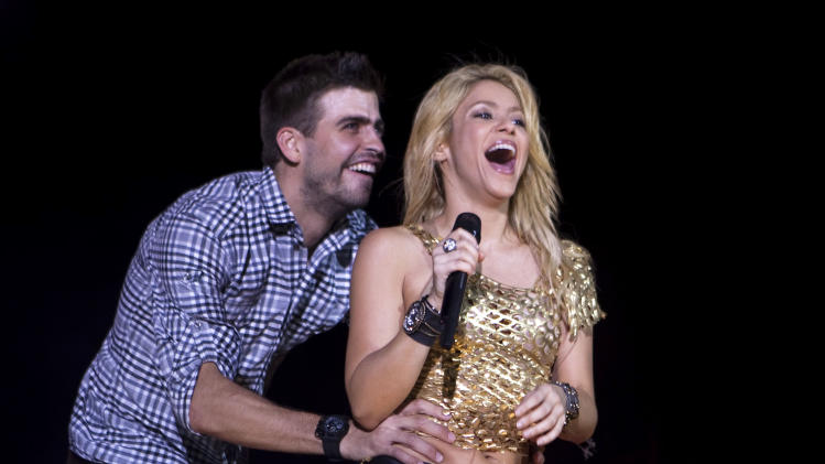 FILE - This May 29, 2011 file photo shows Colombia's singer Shakira performing with FC Barcelona soccer player Gerard Pique during The Sun Comes Out World Tour concert in Barcelona, Spain. It was announced on Wednesday, Jan. 23, 2013,  that singer Sharika Mebarak and soccer player Gerard Pique have welcomed a baby son, Milan Piqué Mebarak, born Tuesday, 22,  in Barcelona, Spain.  (AP Photo/Emilio Morenatti, File)