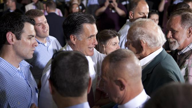 Republican presidential candidate, former Massachusetts Gov. Mitt Romney shakes hands during a campaign stop at Seilkop Industries in Cincinnati, Ohio, Thursday, June 14, 2012.  (AP Photo/Evan Vucci)