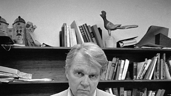 "FILE - In this Aug. 2, 1978 file photo, CBS News producer and correspondent Andrew Rooney poses for photos in his New York office. CBS says former ""60 Minutes"" commentator Andy Rooney died at age 92. (AP Photo/Carlos Rene Perez, File)"