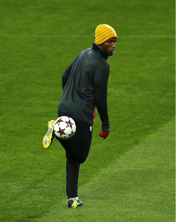 Galatasaray's Didier Drogba from Ivory Coast, controls the ball during a training session  in Madrid, Spain, Tuesday, Nov. 26, 2013.  Galatasaray will play Real Madrid on Wednesday in a Group B Champi