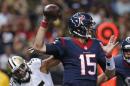 Houston Texans quarterback Ryan Mallett (15) passes under pressure from New Orleans Saints outside linebacker Hau'oli Kikaha (45) in the first half of a preseason NFL football game in New Orleans, Sunday, Aug. 30, 2015. (AP Photo/Jonathan Bachman)