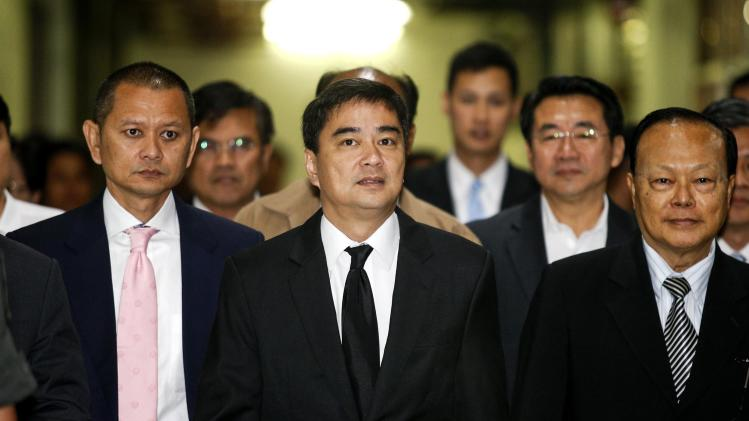 Democrat Party leader and former prime minister Abhisit arrives at Bangkok criminal court