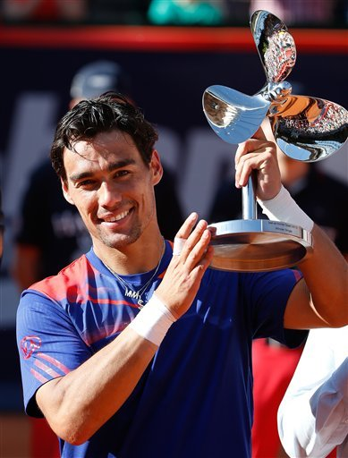 Italy's Fabio Fognini  celebrates with the trophy after he won the final match of the bet-at-home ATP tennis tournament against Argentina's Frederico  Delbonis in Hamburg, Germany Sunday July 21, 2013