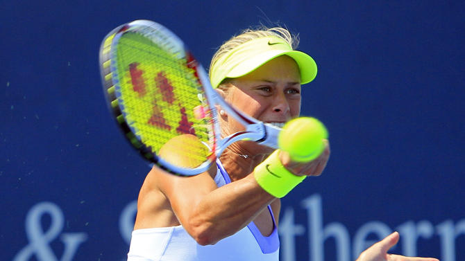 Andrea Hlavackova, from the Czech Republic, hits a forehand shot against Angelique Kerber, from Germany, during a match at the Western & Southern Open tennis tournament, Thursday, Aug. 16, 2012, in Mason, Ohio. (AP Photo/Al Behrman)
