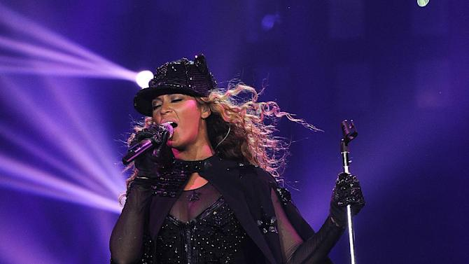 """IMAGE DISTRIBUTED FOR PARKWOOD ENTERTAINMENT - Singer Beyonce performs on her """"Mrs. Carter Show World Tour 2013"""" at the Ziggo Dome on Monday, April 22, 2013 in Amsterdam. Beyonce is wearing a custom hand beaded one-piece by Givenchey. (Photo by Frank Micelotta/Invision for Parkwood Entertainment/AP Images)"""