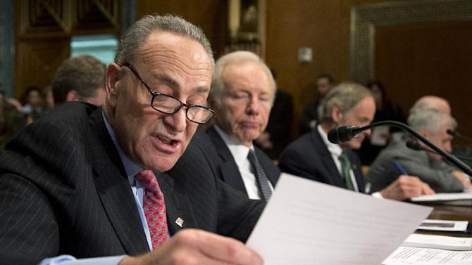 Sen. Charles Schumer, D-N.Y. reads his statement on Capitol Hill in Washington, Wednesday, Dec. 5,2012, as he testified about the devastations in New York from Superstorm Sandy, during a Senate Homeland Security subcommittee hearing to examine Superstorm Sandy, focusing on response and recovery and progress and challenge. From left are, Schumer, Sen. Joe Lieberman, I-Conn., Sen. Thomas Carper, R. D-Del., and Sen. Jack Reed, D-R.I.     (AP Photo/Manuel Balce Ceneta)
