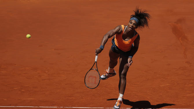 Serena Williams from U.S. serves during the women's final match against Maria Sharapova from Russia at the Madrid Open tennis tournament, in Madrid, Sunday, May 12, 2013. (AP Photo/Andres Kudacki)
