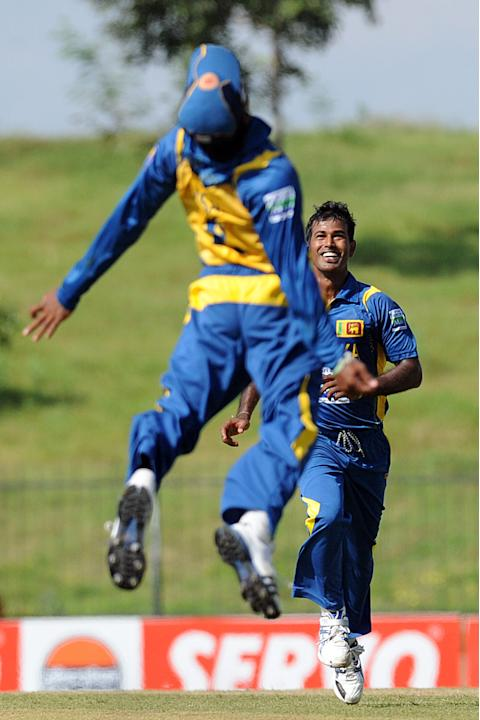 Sri Lankan cricketers Nuwan Kulasekara (R) and Kushal Janith Perera celebrate the dismissal of Bangladeshi cricketer Mohammad Ashraful during the opening one-day international (ODI) match between Sri