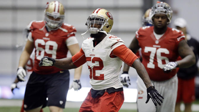 San Francisco 49ers linebacker Patrick Willis (52), practice squad member Kenny Wiggins (69), and tackle Anthony Davis (76) warm up during practice on Friday, Feb. 1, 2013, in New Orleans. The 49ers are scheduled to play the Baltimore Ravens in the NFL Super Bowl XLVII football game on Feb. 3. (AP Photo/Mark Humphrey)