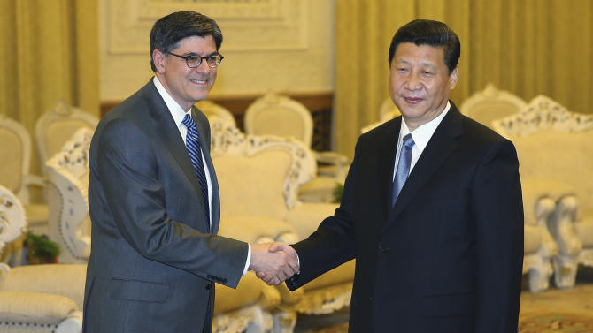 Chinese President Xi Jinping, right, shakes hands with U.S. Treasury Secretary Jacob Lew during his visit to the Great Hall of the People on Tuesday, March 19, 2013, in Beijing, China. Xi  said Beijing wants strong ties with Washington as he held talks with the U.S. Treasury secretary on Tuesday in his first meeting with a foreign official since being appointed president. (AP Photo/ Feng Li, Pool)