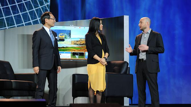 """(left to right) CEO of Panasonic, Kazuhiro Tsuga, Lisa Ling, and Tim Vanderhook of Specific Media demonstrating """"My Home"""" system at the International Consumer Electronics Show 2013, on Tuesday, January 8, 2013, Las Vegas, NV during the Panasonic Keynote presentation (Photo by Al Powers/Invision for Panasonic/AP Images)"""