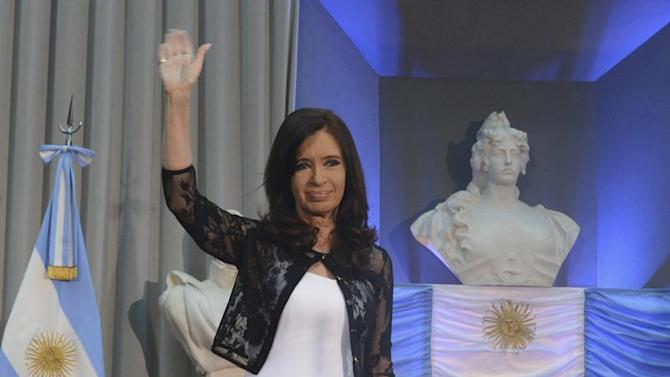 Argentina's President Fernandez waves during event to celebrate anniversary of Argentina's return to democracy in Buenos Aires