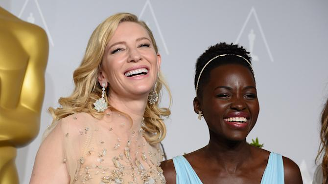 "Cate Blanchett holds her award for best actress in ""Blue Jasmine"", left, and Lupita Nyong'o holds her award for best supporting actress for ""12 Years a Slave,"" in the press room during the Oscars at the Dolby Theatre on Sunday, March 2, 2014, in Los Angeles. (Photo by Jordan Strauss/Invision/AP)"