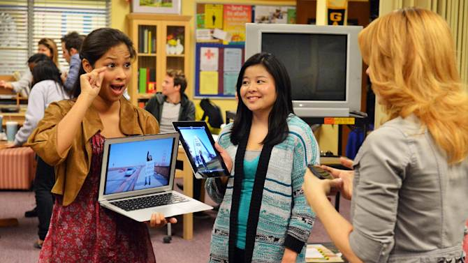 """This publicity image released by ABC Family shows Karla Gutierrez, left, and Ashley Shimizu in a scene from ABC Family's TV series, """"Switched at Birth."""" When news of the school's closing spreads, the students of Carlton School for the Deaf stage a protest. (AP Photo/ABC Family/Eric McCandless)"""