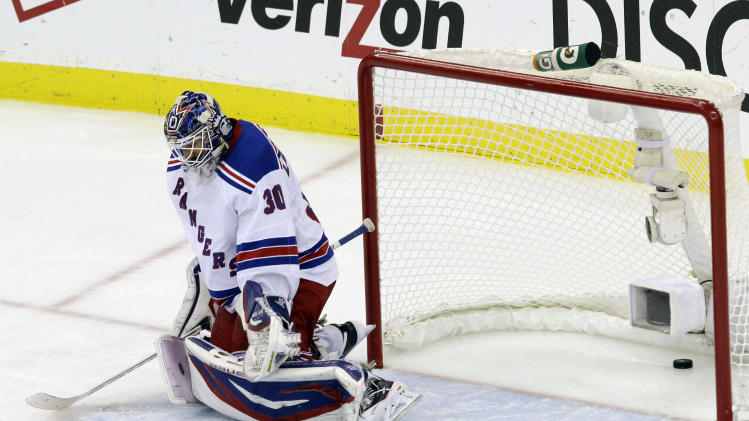 A shot by New Jersey Devils' Bryce Salvador scores past New York Rangers goalie Henrik Lundqvist, of Sweden, during the first period of Game 4 of an NHL hockey Stanley Cup Eastern Conference final playoff series, Monday, May 21, 2012, in Newark, N.J. (AP Photo/Kathy Willens)
