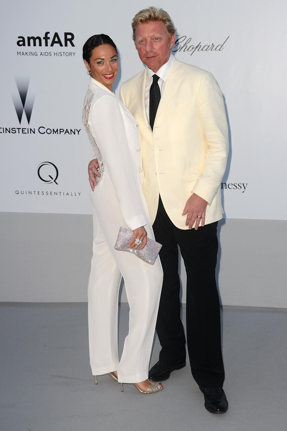 Former tennis player Boris Becker, right, and his wife Lilly arrive for the amfAR Cinema Against AIDS benefit at the Hotel du Cap-Eden-Roc, during the 65th Cannes film festival, in Cap d'Antibes, southern France, Thursday, May 24, 2012. (AP Photo/Jonathan Short)