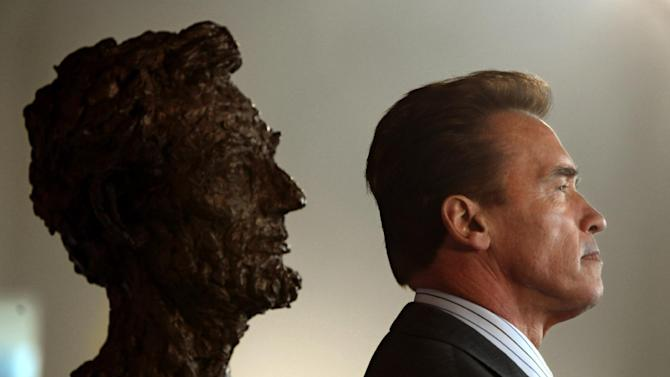 "FILE - In this Feb 11, 2009 file photo, former Gov. Arnold Schwarzenegger and a bust of Abraham Lincoln are seen in profile during a celebration of Lincoln's 200 birthday held at the California Museum of History, Women and the Arts in Sacramento, Calif.  Schwarzenegger, who came to office during California's historic 2003 recall election, will soon be releasing his autobiography, ""Total Recall: My Unbelievably True Life Story.""(AP Photo/Rich Pedroncelli, file)"