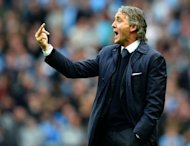 Manchester City manager Roberto Mancini, pictured here on September 23, had a touchline row with Aston Villa boss Paul Lambert during City's 4-2 League Cup third round defeat at Eastlands on Tuesday