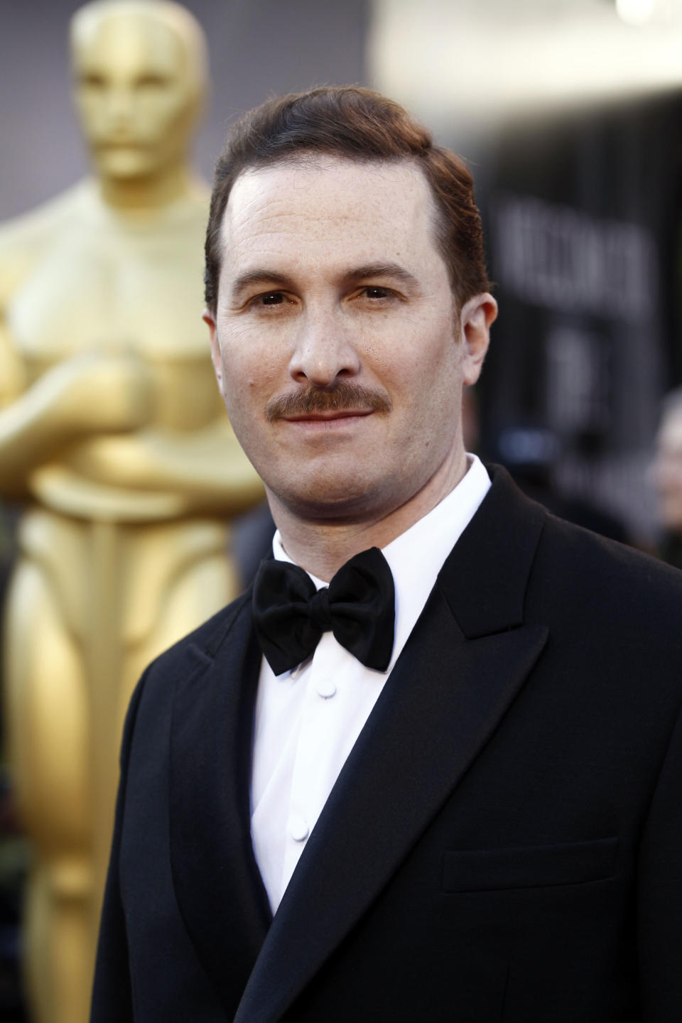 "FILE - In this Feb. 27, 2011 file photo, director Darren Aronofsky arrives before the 83rd Academy Awards in the Hollywood section of Los Angeles. Aronofsky will direct a music video from the new Metallica and Lou Reed album, ""Lulu.""  (AP Photo/Matt Sayles, file)"