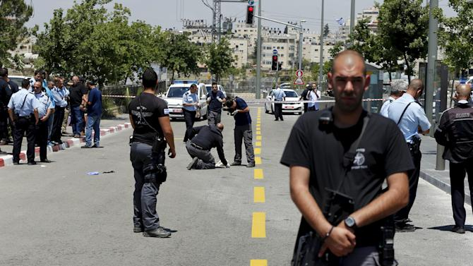 Israeli police officer stands guard at scene of attempted stabbing in Jerusalem