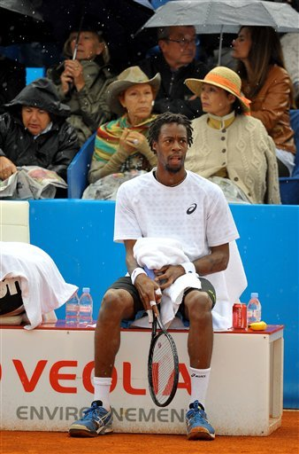 French player Gael Monfils sits on his chair as his final match against Albert Montanes is interrupted by rain at the Nice Cote d'Azur open tournament, in Nice, Southern France, Saturday May 25, 2013