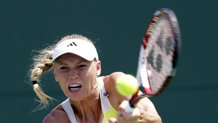Caroline Wozniacki, of Denmark, returns to Garbine Muguruza, of Spain, during the Sony Open tennis tournament in Key Biscayne, Fla.,  Saturday, March 23, 2013. (AP Photo/Alan Diaz)