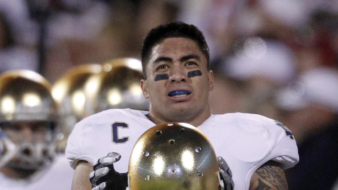 FILE - In this Oct. 27, 2012, file photo, Notre Dame linebacker Manti Te'o stands on the sidelines duringf an NCAA college football game against Oklahoma in Norman, Okla. Te'o is a finalist for the Heisman Trophy. (AP Photo/Sue Ogrocki, File)
