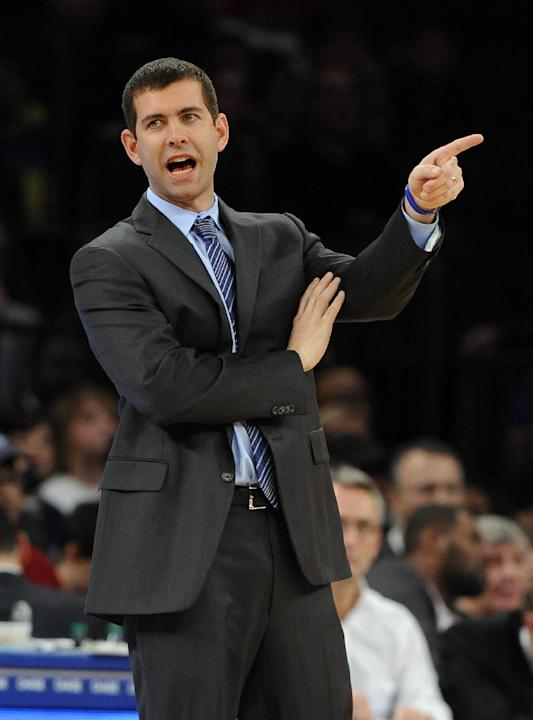 Boston Celtics head coach Brad Stevens directs his team against the New York Knicks during the first half of an NBA basketball game on Sunday, Dec. 8, 2013, in New York. The Celtics won 114-73