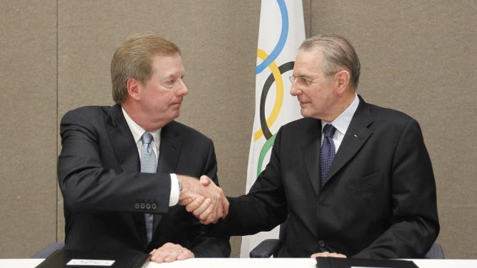 FILE - In this May 24, 2012 file photo, United States Olympic Committee chairman Larry Probst, left, and Olympic Committee President Jacques Rogge shake hands after signing an agreement between the IOC and the USOC at the SportAccord conference in Quebec City. Probst has been elected to the IOC, a big boost for the U.S. to regain influence on the Olympic stage. Probst made it onto the International Olympic Committee on Tuesday, Sept. 10, 2013, with 71 votes in favor and 20 against. (AP Photo/Mathieu Belanger, Pool, File)