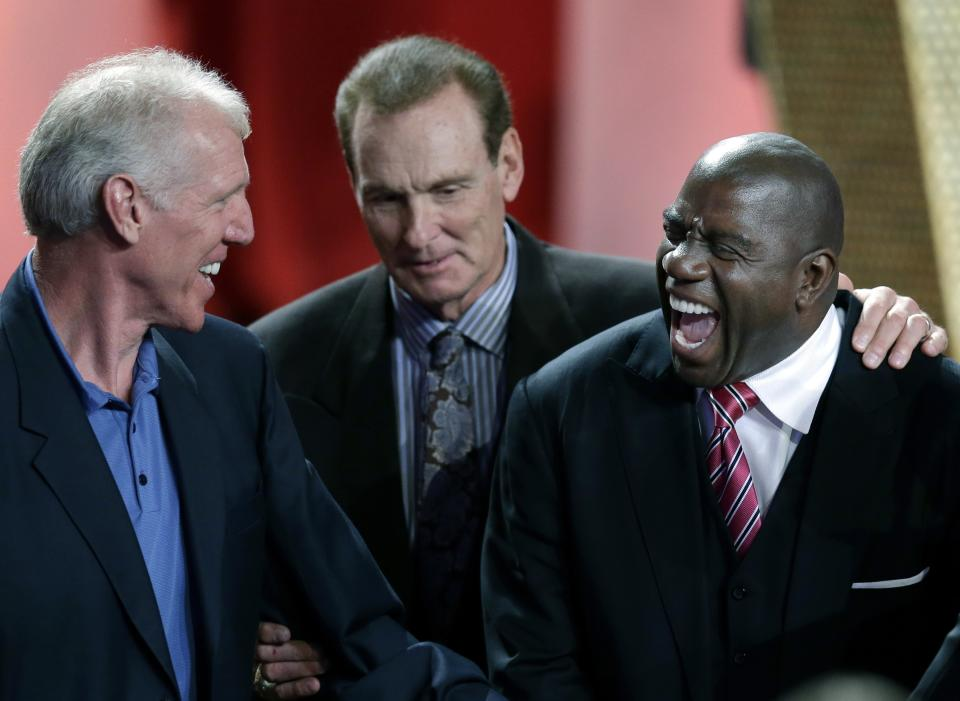 "Earvin ""Magic"" Johnson, right, laughs with Bill Walton, left, and Rick Barry during the enshrinement ceremony for the 2012 class of the Naismith Memorial Basketball Hall of Fame at Symphony Hall in Springfield, Mass. Friday, Sept. 7, 2012. (AP Photo/Elise Amendola)"