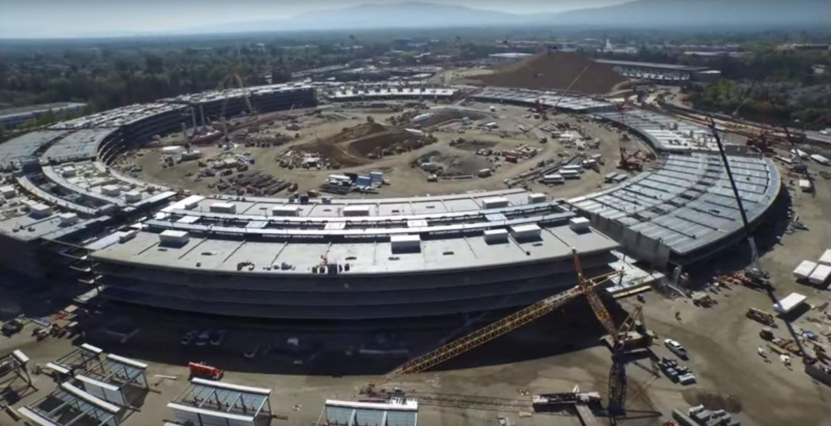 A drone above Apple's new spaceship headquarters got this amazing spy video