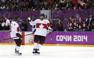Canada's Weber celebrates his goal against Latvia with teammate Doughty during the third period of their men's quarter-finals ice hockey game at the 2014 Sochi Winter Olympic Games
