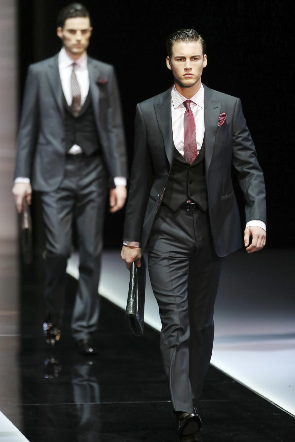 Models wear creations for Giorgio Armani men's Fall-Winter 2013-14 collection, part of the Milan Fashion Week, unveiled in Milan, Italy, Tuesday, Jan. 15, 2013. (AP Photo/Antonio Calanni)