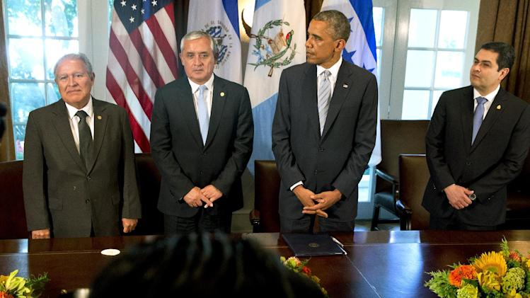 El Salvador's President Salvador Sanchez Ceren, left, Guatemala's President Otto Perez Molina, U.S. President Barack Obama, and Honduran President Juan Hernandez stand up at the end of their meeting to discuss Central American immigration and the border crisis in the Cabinet Room of the White House Friday, July 25, 2014, in Washington. (AP Photo)