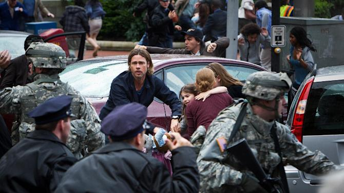 """This publicity photo released by Paramount Pictures shows, center, Brad Pitt as Gerald Lane in a scene from the film, """"World War Z,"""" from Paramount Pictures and Skydance Productions in association with Hemisphere Media Capital and GK Films. (AP Photo/Paramount Pictures, Jaap Buitendijk)"""