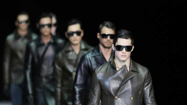 Models wear creations for Emporio Armani men's Fall-Winter 2013-14 collection, part of the Milan Fashion Week, unveiled in Milan, Italy, Monday, Jan. 14, 2013. (AP Photo/Antonio Calanni)