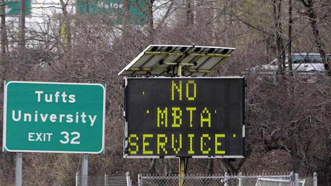 A sign along I-93 in Medford, Mass. announces no MBTA service Friday, April 18, 2013. Two suspects in the Boston Marathon bombing killed an MIT police officer, injured a transit officer in a firefight and threw explosive devices at police during their getaway attempt in a long night of violence that left one of them dead and another still at large Friday, authorities said as the manhunt intensified for a young man described as a dangerous terrorist. (AP Photo/Elise Amendola)
