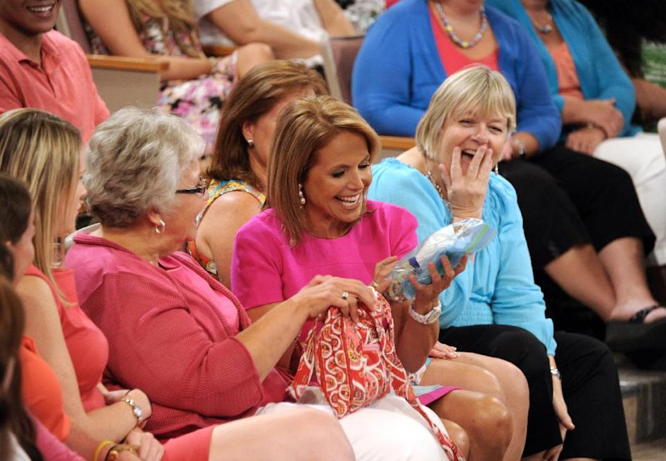 "This Aug. 8, 2012 photo released by Disney-ABC Domestic Television shows host Katie Couric sitting with audience members during a taping of her new talk show ""Katie."" Couric's new show will debut on Monday, Sept. 10. (AP Photo/Disney-ABC Domestic TV, Ida Mae Astute)"