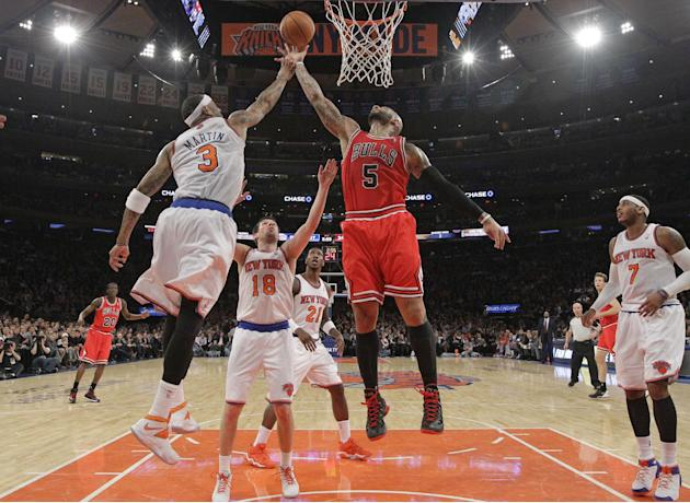 New York Knicks forward Kenyon Martin (3) defends as Chicago Bulls forward Carlos Boozer (5) goes up for a layup in the second half of their NBA basketball game at Madison Square Garden in New York, W