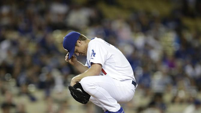 Hamels loses to Dodgers in 1st start of season