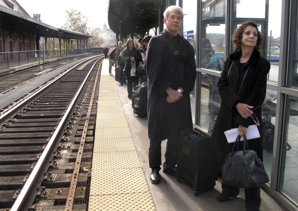 Fred Errington, left, and Deborah Gewertz of Amherst, Mass., wait for an Amtrak train to arrive at Union Station in Hartford, Conn., Wednesday, Nov. 21, 2012. They planned to travel to New York City on the busiest travel day of the year to meet friends for Thanksgiving  (AP Photo/Dave Collins)