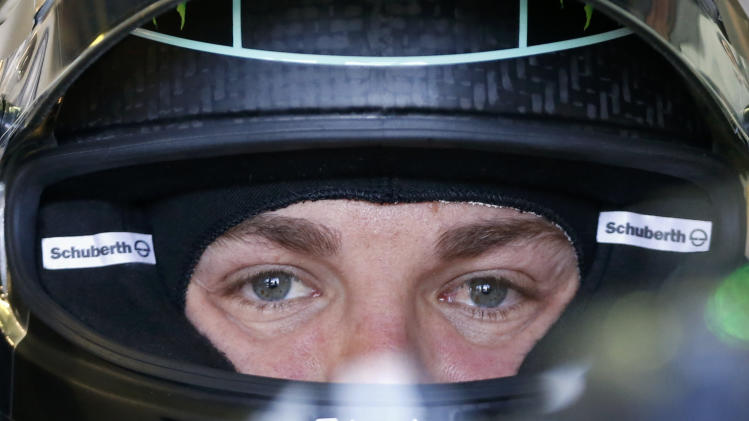 Mercedes Formula One driver Rosberg of Germany looks on during the first practice session of the Australian F1 Grand Prix in Melbourne