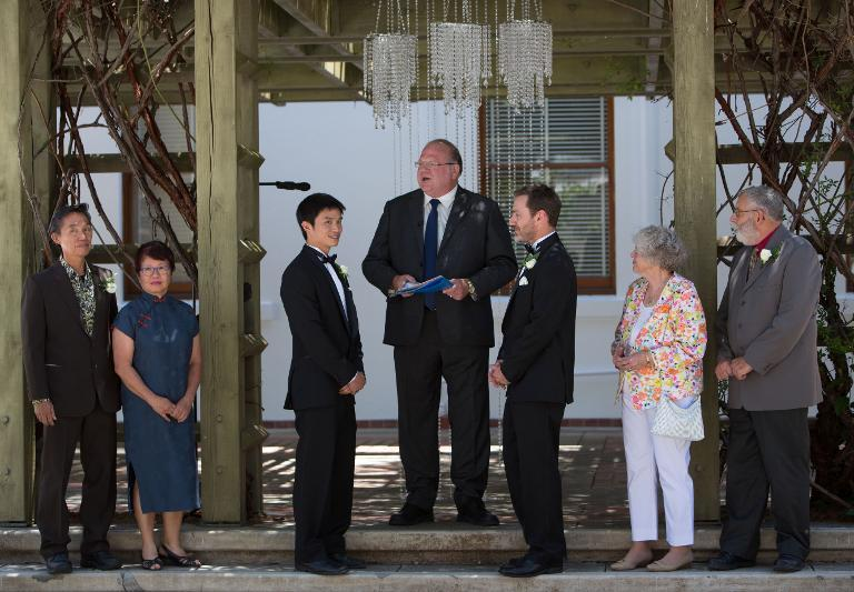 An Australian gay couple exchange vows during their marriage at Canberra's Old Parliament House on December 7, 2013