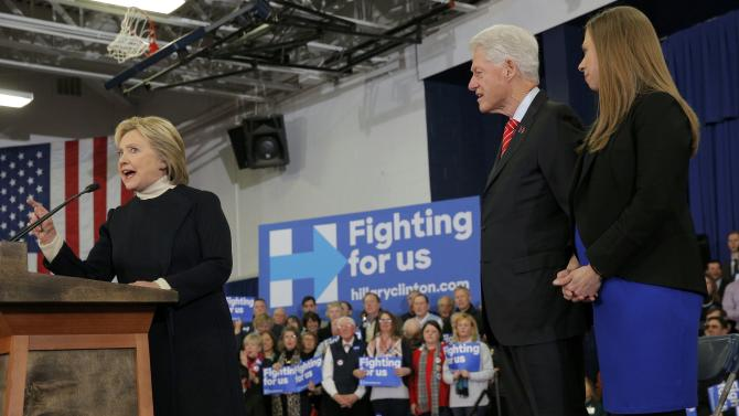 Democratic U.S. presidential candidate Hillary Clinton is accompanied by her daughter Chelsea and her husband President Clinton as she speaks to supporters at her final 2016 New Hampshire presidential primary night rally in Manchester