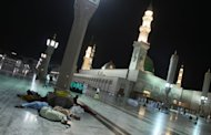 Muslim pilgrims sleep near Prophet Mohammed Mosque in the Saudi holy city of Medina in 2009. Saudi King Abdullah, who has just returned to the kingdom after a month-long absence, has launched a huge expansion project for the Prophet's mosque in the holy city of Medina, the state news agency reported